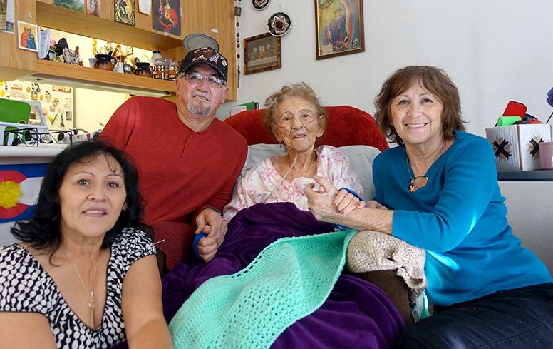 104-year-old resident Rafelita sits with with her family in her Mercy Housing home.