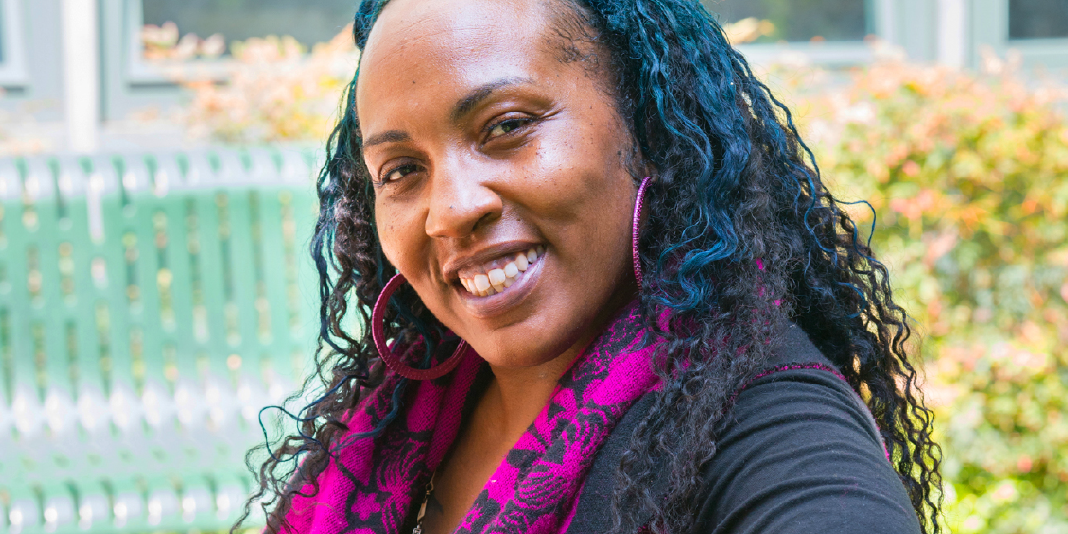 Headshot of smiling woman, Kai Bluford, who is our Resident Services Coordinator